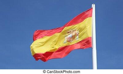 Spanish national flag - Spanish national flag against a blue...