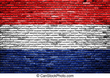 netherlands flag painted on old brick wall
