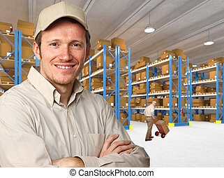 delivery man - smiling worker in warehouse work place