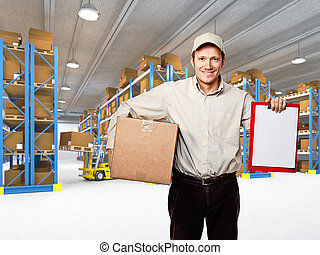 smiling worker in warehouse - caucasian delivery man in...