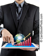 Business man holding the modern digital tablet pc with success growth chart and earth
