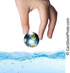 Earth in hand over water (Elements of this image furnished...