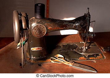 old stitching machine in the workshop of a tailor