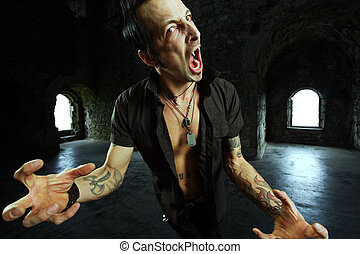 Male vampire attack - Photo of a male vampire with mouth...