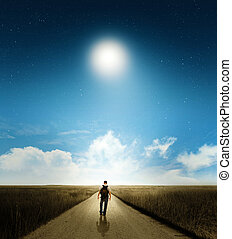 Walk with moon - A man walking down country road under moon...