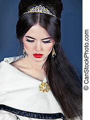Beautiful woman with evening make-up and hair style. Jewelry and Beauty. Fashion photo