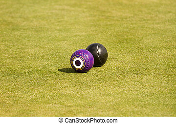 Lawn bowls - two lawn bowls on a green