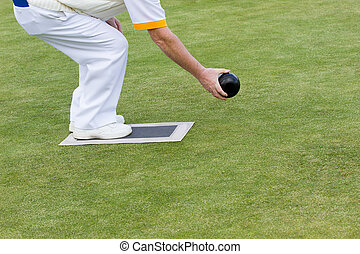 Lawn bowling - bowl in the process of being played