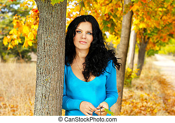 Portrait of Relaxed Woman, outdoors autumn park