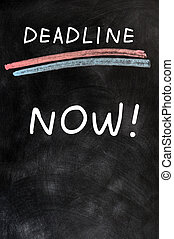 Deadline Now written on a blackboard - Deadline Now written...
