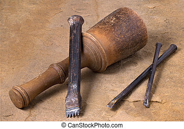 a mallet with three chisels