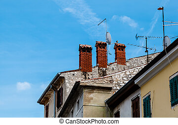 Three Red Chimneys on Roof in Porec, Croatia