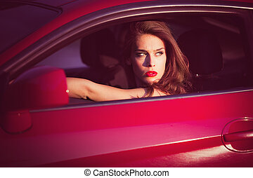 woman in red car - attractive green eyes woman look of red...