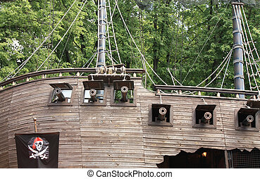 Side of a pirate schooner - Wooden sailing aboard with...
