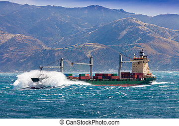 Loaded container freight ship in stormy sea - Loaded...