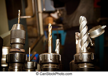 Drilling machine bits in a high precision mechanics plant.