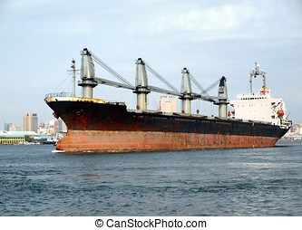 Large Freighter Leaves Kaohsiung Port - A large cargo ship...