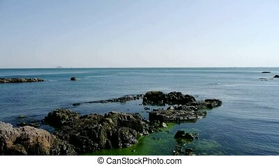 Ocean water surface and rock reef...