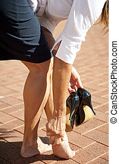 Health and high heel shoes - Business woman with sore feet...