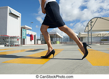 Sexy woman crossing street - Sexy high heeled legs of a...