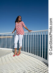 Sexy high heel lady at ocean