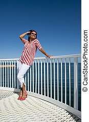 Sexy high heel woman at sea - A sexy looking mature woman,...