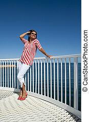 Sexy high heel woman at sea