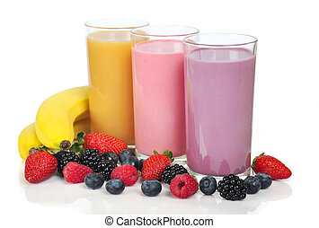 Three glasses of smoothies with different berries and...
