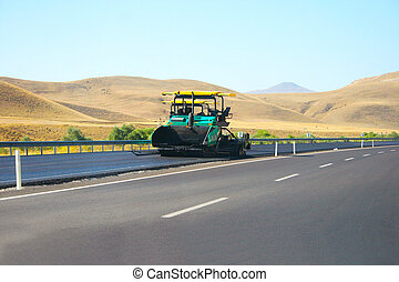 Asphalt paving machine on mountain road in Turkey