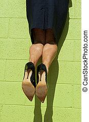 High heel legs hanging mid air