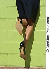 Sexy high heel legs hanging mid air - Sexy legs of a woman,...