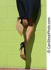 Sexy high heel legs hanging mid air
