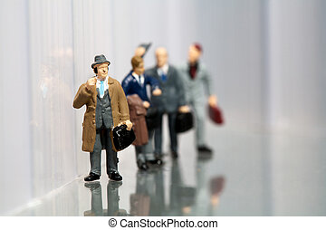 Line-up of office workers - Line-up of tiny miniature...