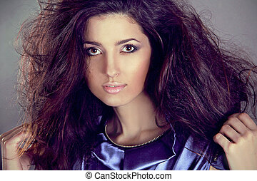 Fashion brunette woman model with long hair in motion. Beauty and Fashion photo
