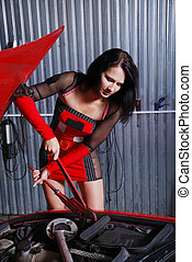 Pretty woman repairing the car - A sexy girl is fixing...