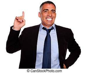 Hispanic senior businessman pointing up