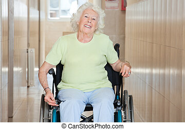 Happy Senior Woman Sitting In a Wheel Chair