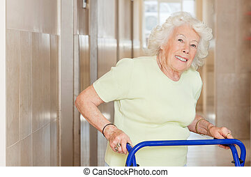Happy Senior Woman Using Zimmer Frame - Portrait of a happy...