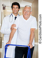 Doctor Helping An Old Man With His Walker - Young happy...
