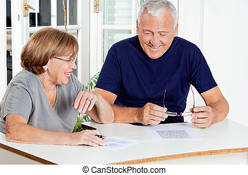 Couple Playing Leisure Games - Happy senior couple playing...