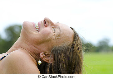 Mature woman relaxed in park - Portrait of an attractive...