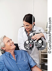 Optometrist And Patient Before Eye Checkup