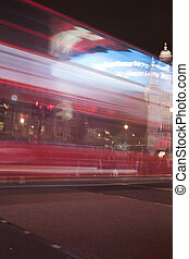 Bus at Piccadilly Circus, London - A bus speeding by at a...