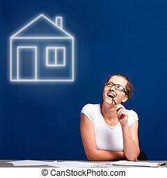 dream house - woman is sitting at table and thinking about a...