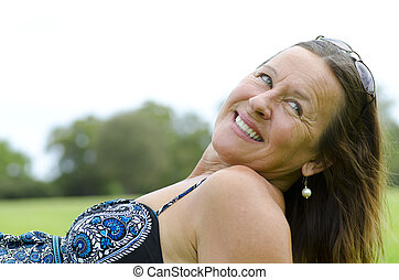 Beautiful woman relaxed in park - Portrait of an attractive...