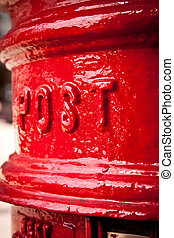 Postbox detail - Post and mail theme: close-up on red UK...