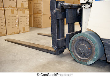 Forklift in warehouse - Close Up image of an obviously used...