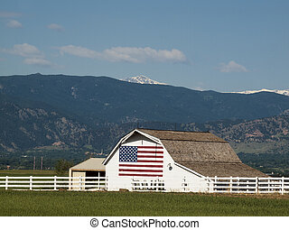 White Barn - White barn with painted American Flag in...