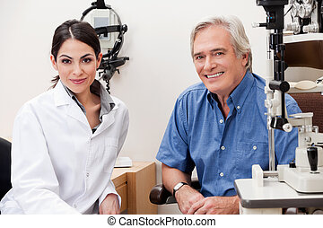 Smiling Optometrist With Her Patient - Confident female...