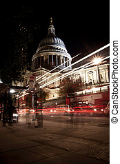 Traffic by St Paul's Cathedral at night, London. Blurred...
